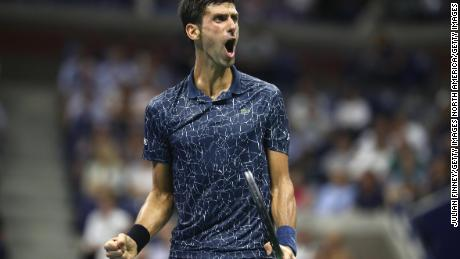 Novak Djokovic of Serbia celebrates a point during his men's singles quarter-final match against John Millman of Australia at the 2018 US Open.