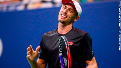 Millman reacts after losing a point to Djokovic during their quarterfinal match.