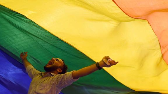 "A member of the lesbian, gay, bisexual, transgender (LGBT) community celebrates the Supreme Court decision to strike down a colonial-era ban on gay sex, in Mumbai on September 6, 2018. - India's Supreme Court on September 6 struck down the ban that has been at the centre of years of legal battles. ""The law had become a weapon for harassment for the LGBT community,"" Chief Justice Dipak Misra said as he announced the landmark verdict. (Photo by INDRANIL MUKHERJEE / AFP)        (Photo credit should read INDRANIL MUKHERJEE/AFP/Getty Images)"