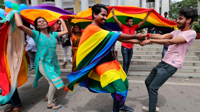Members of India's LGBT community dance in celebration after the ruling was announced in Bangalore on Thursday.