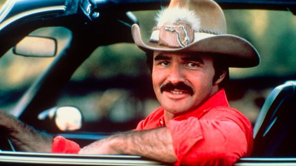 """Actor Burt Reynolds, whose easygoing charms and handsome looks drew prominent roles in films such as """"Smokey and the Bandit"""" and """"Boogie Nights,"""" died Thursday, September 6. He was 82 years old."""