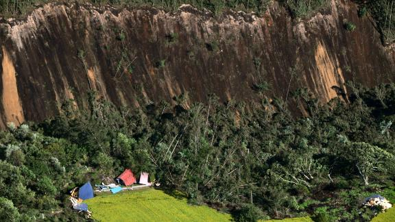 ATSUMA, JAPAN - SEPTEMBER 06:  (CHINA OUT, SOUTH KOREA OUT) In this aerial image, houses are buried by multiple landslides after a powerful earthquake at Yoshino district on September 6, 2018 in Atsuma, Hokkaido, Japan. The magnitude 6.7 strong earthquake, struck 3:08 am, causes landslides, 3 million households in Hokkaido suffer a blackout.  (Photo by The Asahi Shimbun via Getty Images)