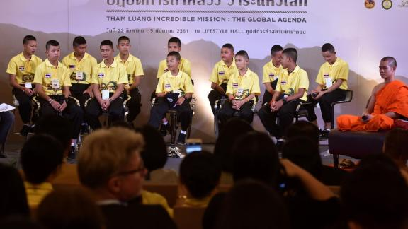 """The Wild Boars soccer team and their coach, right, join in a """"meet the press"""" event Thursday in Bangkok."""
