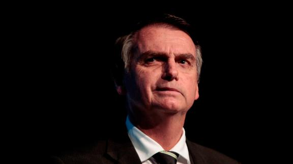 The Brazilian presidential candidate for the Social Liberal Party, Jair Bolsonaro, gestures during the Brazilian Sugarcane Industry Association's Unica Forum 2018 in Sao Paulo, Brazil, on June 18, 2018. - Brazil holds general elections in October. (Photo by Miguel SCHINCARIOL / AFP)        (Photo credit should read MIGUEL SCHINCARIOL/AFP/Getty Images)