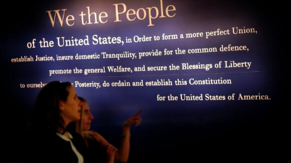 PHILADELPHIA - JULY 1: Two women walk past a painting of the beginning of the U.S. Constitution during a preview of the National Constitution Center July 1, 2003 in Philadelphia, Pennsylvania. The National Constitution Center will be the only museum in the U.S. dedicated to honoring and explaining the U.S. Constitution. Supreme Court Justice Sandra Day O'Connor will receive the Philadelphia Liberty Medal at the NCC's grand opening on July 4, 2003.  (Photo by William Thomas Cain/Getty Images)