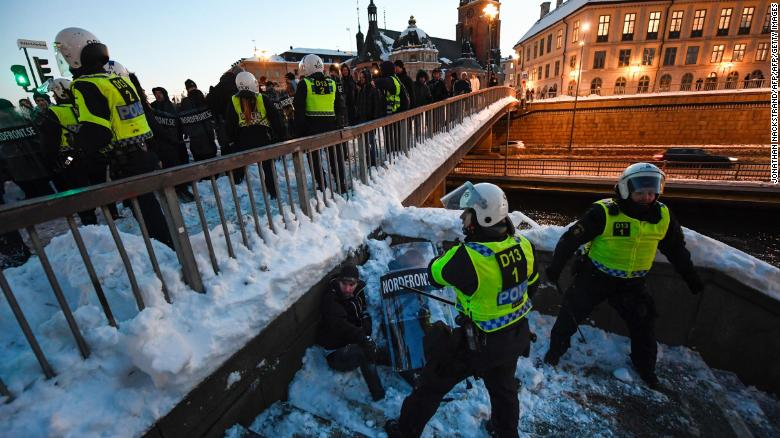 Police separate demonstrators in Stockholm in November 2016 after a protest against migrants.