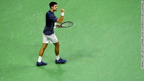 Novak Djokovic of Serbia celebrates victory following his men's singles semifinal match against Japan's Kei Nishikori.