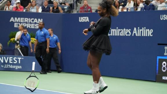 Serena Williams of the US smashes her racquet while playing against Naomi Osaka of Japan during their Women's Singles Finals match at the 2018 US Open at the USTA Billie Jean King National Tennis Center in New York on September 8, 2018.