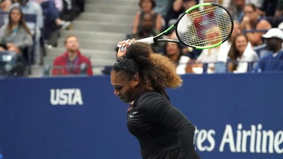 Serena Williams of the US smashes her racquet while playing against Naomi Osaka of Japan during their Women