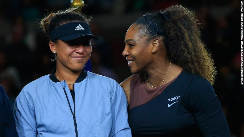 The two finalists share a laugh during the trophy ceremony.
