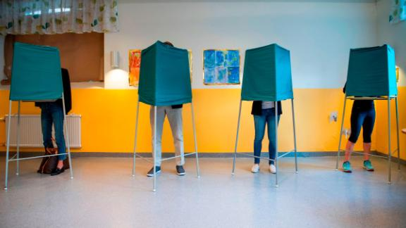 Voters mark their choices at a polling station in Stockholm on Sunday.