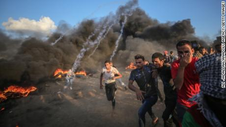 "Israeli forces launch tear gas canisters during a  ""Great March of Return"" demonstration near the Israel-Gaza border on September 7, 2018."