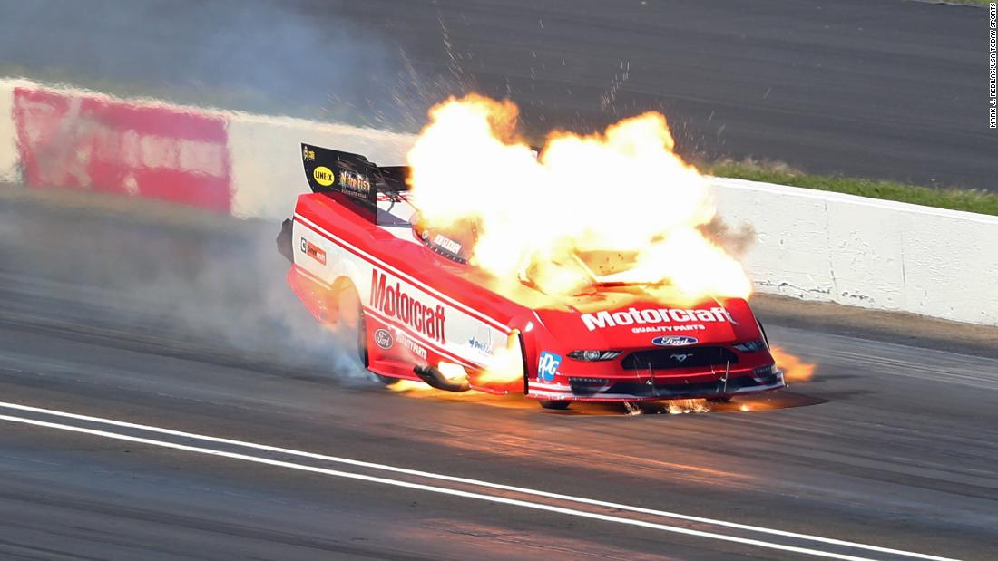 An NHRA funny car driven by Bob Tasca III catches fire during the US Nationals at Lucas Oil Raceway on Monday, September 3. Tasca was not injured.