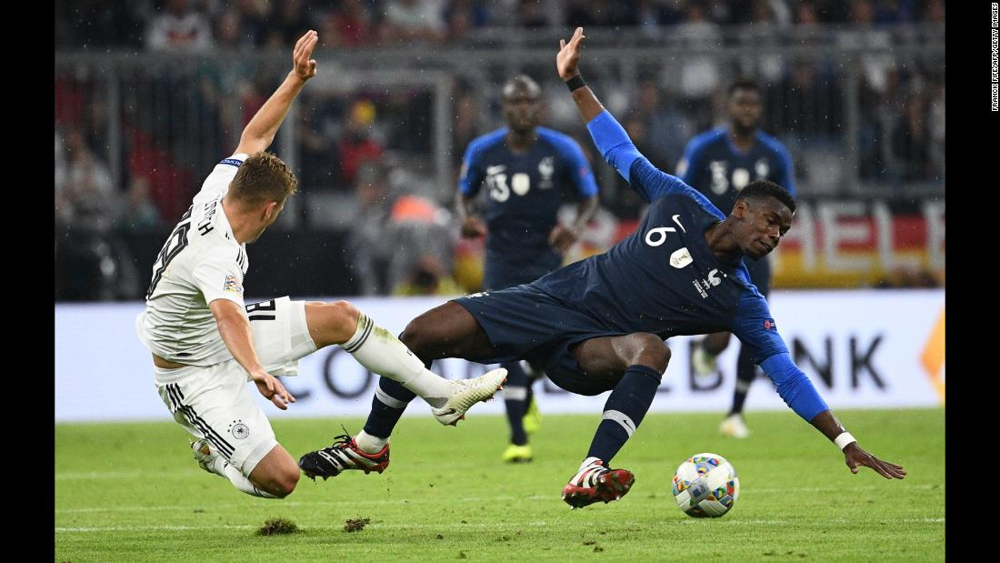 France midfielder Paul Pogba vies with Germany midfielder Joshua Kimmich during the UEFA Nations League football match on Thursday, September 6, at the Allianz Arena in Munich, Germany.