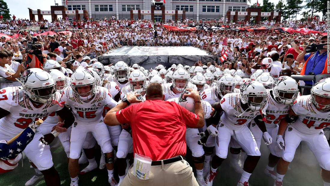 North Carolina State head coach Dave Doeren with his team before they take the field against the Georgia State Panthers at Carter-Finley Stadium on Saturday, September 8, in Raleigh, North Carolina.