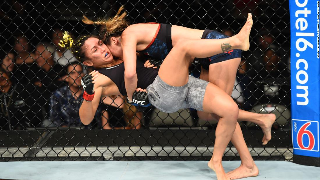 Tatiana Suarez takes down Carla Esparza in their women's strawweight fight during the UFC 228 event at American Airlines Center on Saturday, September 8, in Dallas.