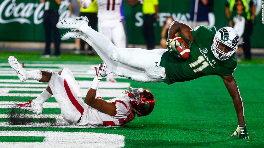 Colorado State Rams' Preston Williams hauls in a touchdown catch over Arkansas' Jarques McClellion. The Rams rallied from a 27-9 deficit to post a 34-27 win over the Razorbacks in Fort Collins on Saturday, September 8.