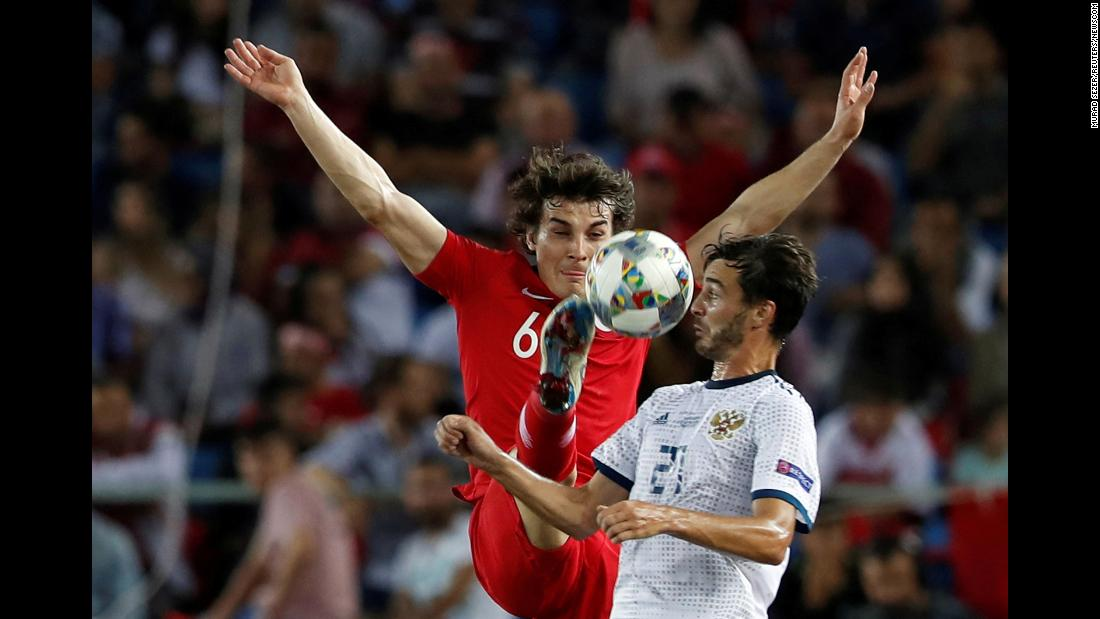 Turkey's Caglar Soyuncu in action with Russia's Aleksandr Erokhin during a UEFA Nations League match on Friday, September 7.