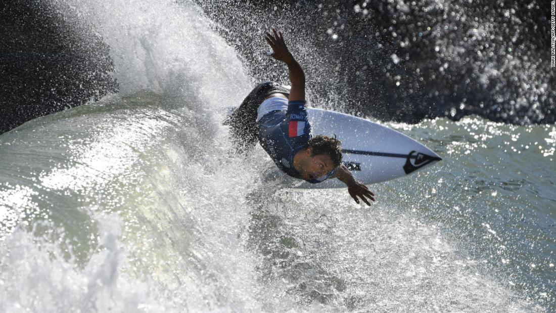 Jeremy Flores surfs off the lip during the qualifying round of the WSL Surf Ranch Pro at the Kelly Slater Surf Ranch in Lemoore, California, on Saturday, September 8. The four-day event brings the world's top surfers to compete on perfect machine-created waves in a half-mile long wave pool situated 100 miles inland from the Pacific Ocean.