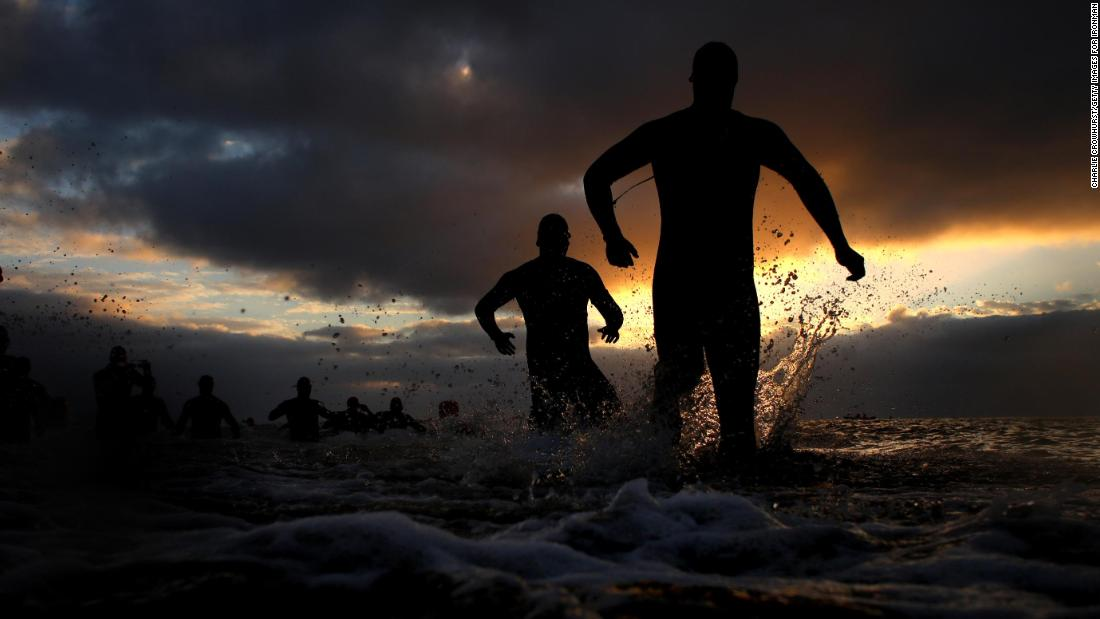 Participants compete in the swim leg of the race during Ironman Wales on Saturday, September 8, in Tenby, Wales.