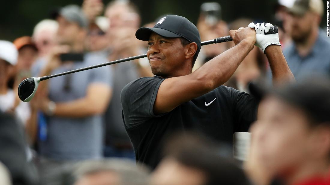 Tiger Woods plays his shot from the seventh tee during the third round of the BMW Championship at Aronimink Golf Club on Saturday, September 8, in Newtown Square, Pennsylvania.
