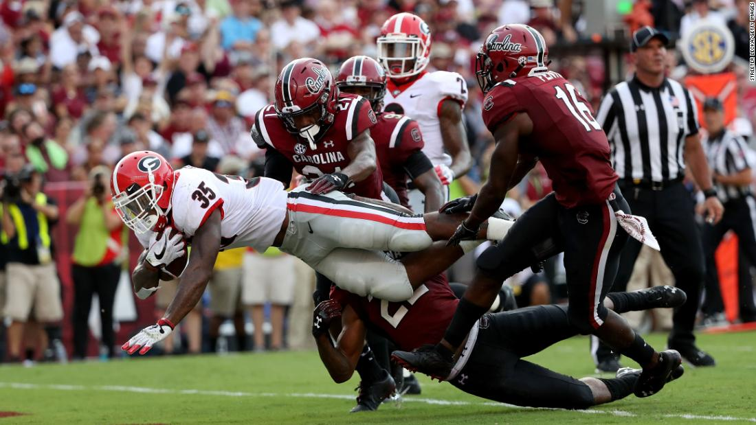 Rashad Fenton of the South Carolina Gamecocks watches as Brian Herrien of the Georgia Bulldogs drives for a touchdown during their game at Williams-Brice Stadium on Saturday, September 8, in Columbia, South Carolina.
