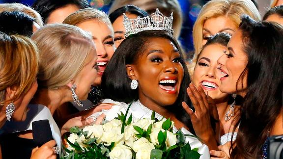 Miss New York Nia Franklin, center, reacts after being named Miss America 2019, Sunday, Sept. 9, 2018, in Atlantic City, N.J. (AP Photo/Noah K. Murray)