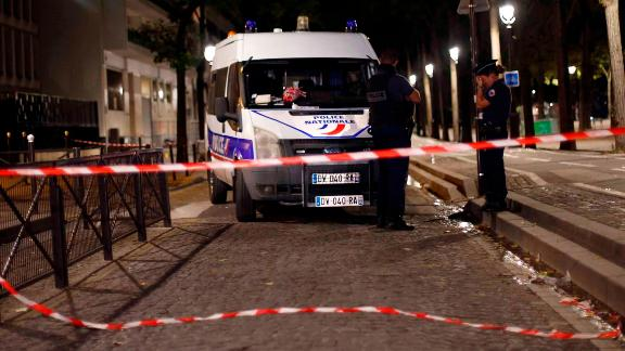 Police officers secure the site of the knife attack Monday in Paris.