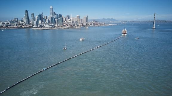 A boat tows the Ocean Cleanup System 001 from San Francisco on Saturday.