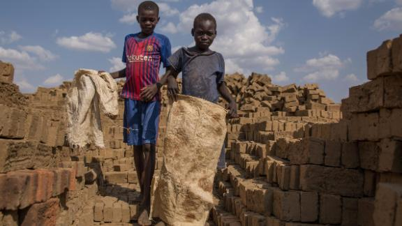 Children carry bricks to an oven near Nyamlel, South Sudan on March 22, 2018. Child labour has been on the rise in South Sudan, a country where 60 percent of the population is under 18 and Unicef says that over 70 percent of children dont attend school. In Nyamlel, up to 30 children work in the brickmaking business and they make between 50-100 South Sudanese Pounds (1USD = 240 SSP on the black market). A brick factory owner said that he hires children because they are cheaper and he additionally thinks he is helping families survive.