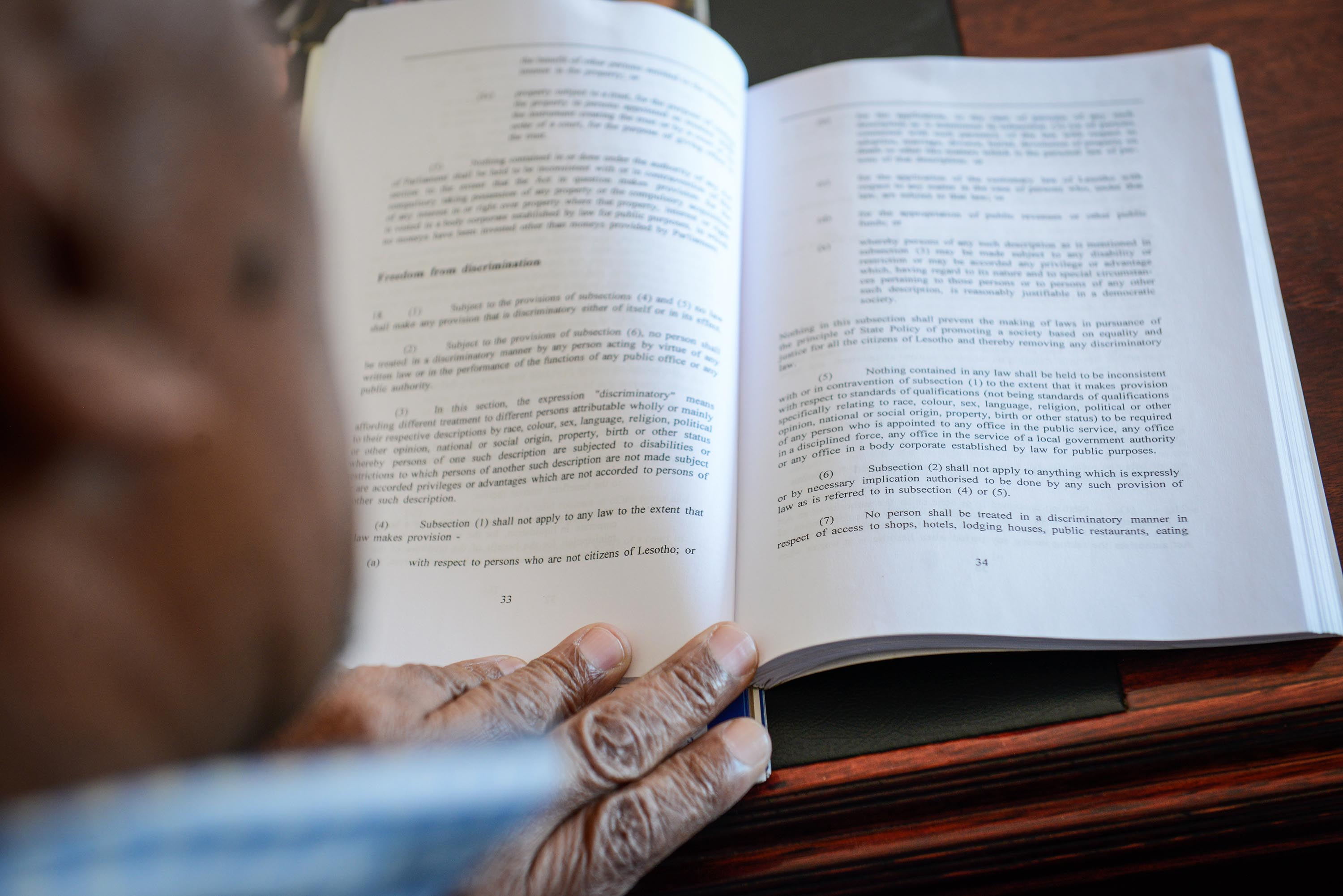Khoabane Theko, principal chief of Thaba Bosiu, reads the law against discrimination in the Constitution of Lesotho.