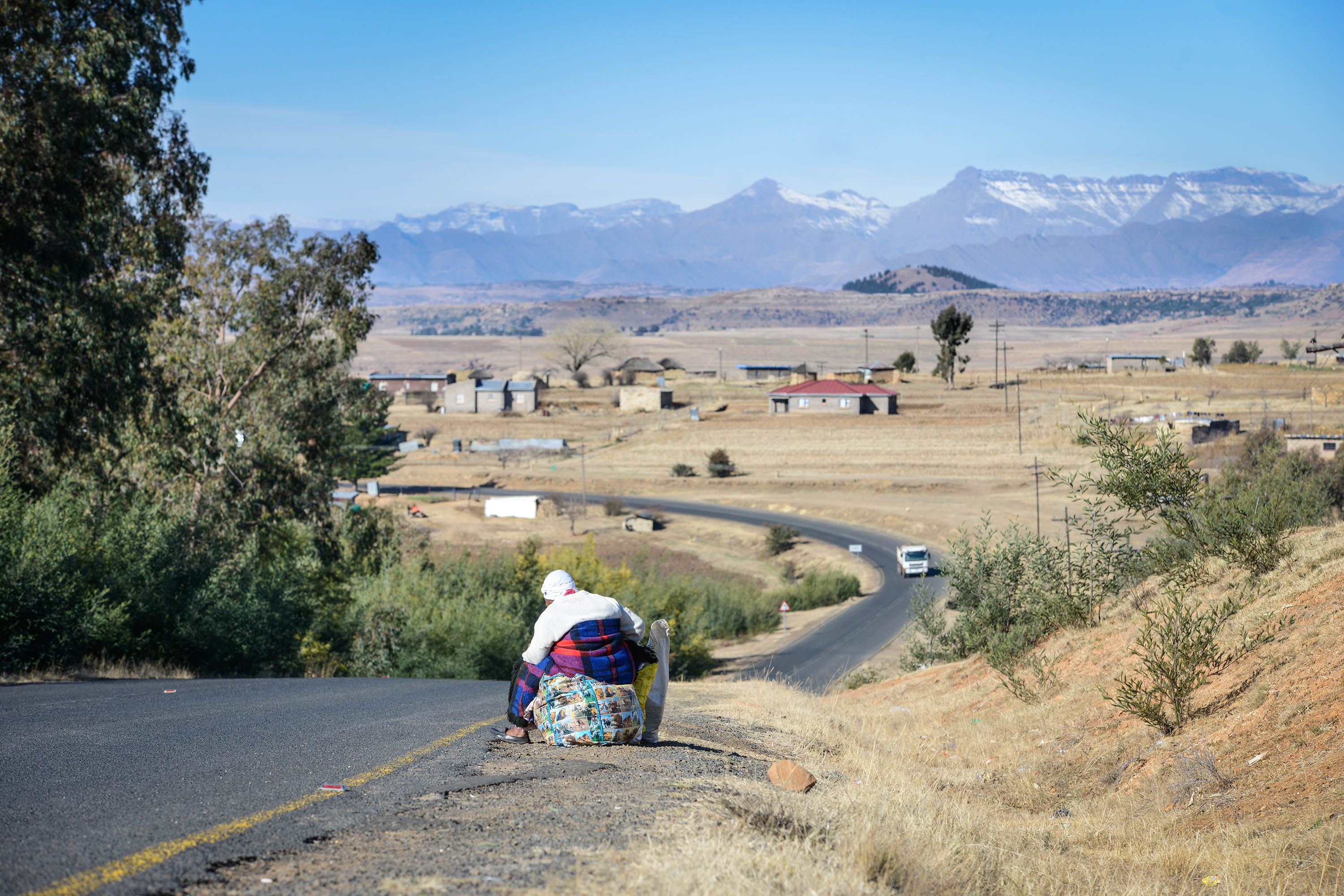 "A 70-year-old woman, who did not want to be identified, waits for a taxi on the outskirts of Ha Mamathe. She supports Masupha's fight. ""Even if she was a girl, she had the right to be a chief,"" she says."