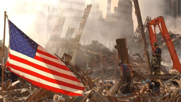 Urban Search and Rescue teams work to clear rubble and search for survivors at the World Trade Center September 16, 2001 New York City, NY. (Photo by Andrea Booher/FEMA/Getty Images)