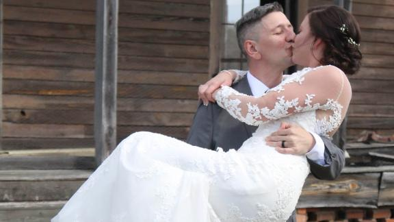 Brittany and Ryan Coleman kiss on their wedding day in February.