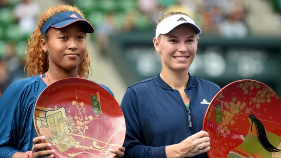 - Osaka finished 2016 by reaching her first WTA final. After being handed a wildcard to compete at the Toray Pan Pacific Open, the youngster (left) finished runner-up behind  Caroline Wozniacki (right). The successful year yielded rich rewards for Osaka. She broke into the world Top 50, signed a worldwide marketing agreement and was voted newcomer of the year at the WTA Awards.