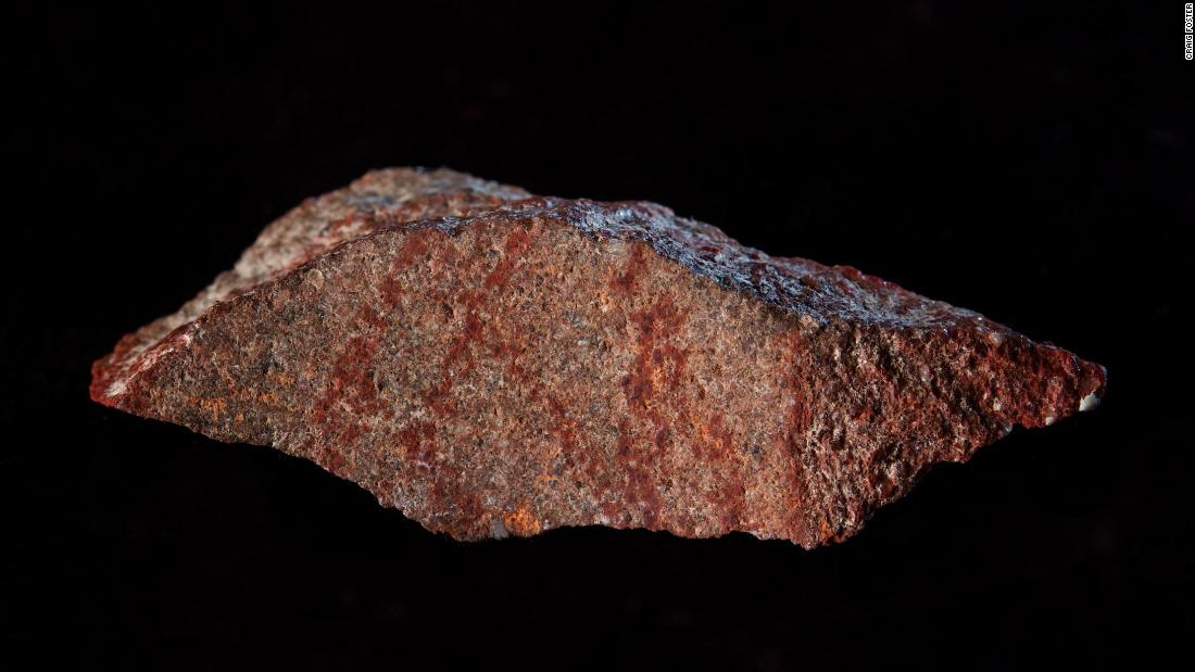 A 73,000-year-old red cross-hatch pattern was drawn on a flake of silicrete, which forms when sand and gravel cement together, and found in a cave in South Africa.