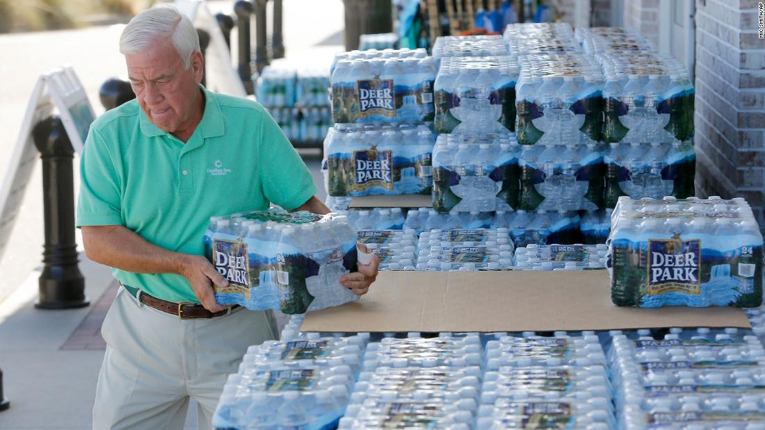Larry Pierson buys bottled water at a grocery store in Isle of Palms, South Carolina.