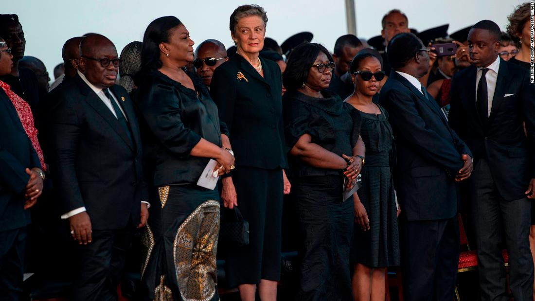 Annan's widow Nane Maria Annan (4thL) standing with other family members as Annan's body is welcome and the President of Ghana Nana Akufo-Addo.