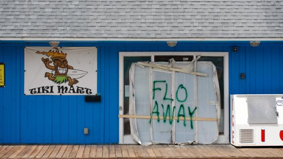 """A Tiki bar sits empty with the message """"FLO AWAY"""" September 11, 2018 on Topsail Island, North Carolina, where homes and businesses have boarded up and left for higher ground before the arrival of of Hurricane Florence. (Photo by Logan Cyrus / AFP)        (Photo credit should read LOGAN CYRUS/AFP/Getty Images)"""