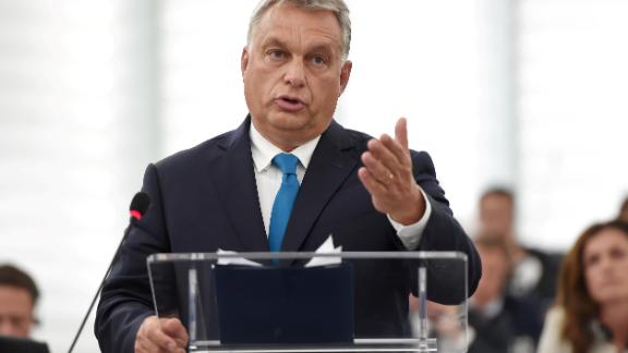 "Hungary's Prime Minister Viktor Orban gestures as he delivers a speech during a debate concerning Hungary's situation as part of a plenary session at the European Parliament on September 11, 2018 in Strasbourg, eastern France. - Hungarian Prime Minister Viktor Orban vowed, on September 11, 2018, to defy EU pressure to soften his hardline anti-migrant stance, condemning what he called the ""blackmail"" of his country. (Photo by FREDERICK FLORIN / AFP)        (Photo credit should read FREDERICK FLORIN/AFP/Getty Images)"