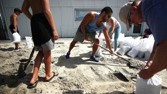 People fill sandbags in Wrightsville Beach, North Carolina, on September 11.