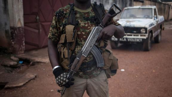 An armed militiaman stands guard in the majority Muslim district of Bangui, Central African Republic.