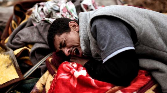 West Mosul residents mourn relatives killed by an airstrike targeting ISIS jihadists. Iraq was named the world's second-most negative country in Gallup's annual Global Emotions Report.