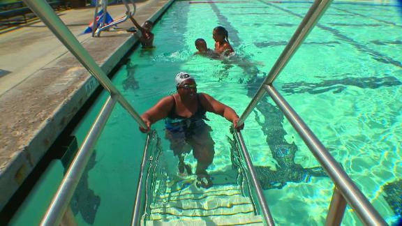 Vivian Stancil, 71, swims at a pool in Riverside, California. She first learned to swim when she was 50.