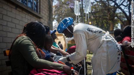 A nurse attends to patients at the cholera treatment center of the Beatrice Infectious Diseases Hospital in Harare in Zimbabwe on September 11, 2018.