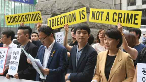 South Korean activists and conscientious objectors to military service are seen during a rally outside the Constitutional Court in Seoul on June 28.