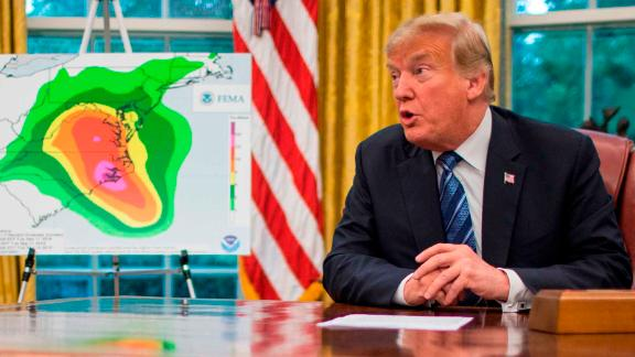 President Donald Trump speaks to members of the press following a briefing on Hurricane Florence in the Oval Office at the White House September 11, 2018 in Washington, DC.  At right is Vice President Mike Pence. (Photo by ZACH GIBSON / AFP)        (Photo credit should read ZACH GIBSON/AFP/Getty Images)