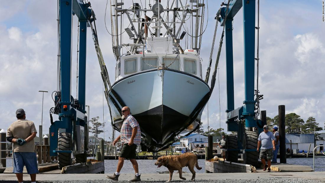Workers take boats out of the water in Wanchese Harbor in Wanchese, North Carolina, on September 12 as the Outer Banks prepares for Florence.
