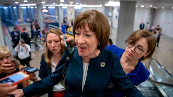FILE - In this Aug. 21, 2018, file photoSen. Susan Collins, R-Maine, speaks with reporters on an escalator at the Capitol in Washington. John McCain is being remembered as a last lion of the Senate, with few others matching his stature. (AP/J. Scott Applewhite, File)