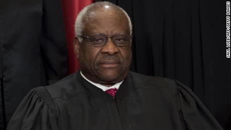 US Supreme Court Justice Clarence Thomas sits for an official photo.